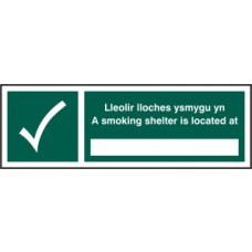 A smoking shelter is located at ______ (Welsh / English) - SAV (300 x 100mm)